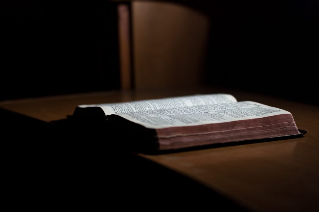 Where is Lavender Grown: The Bible open on a desk in low light as lavender is speculated to be in the Gospel